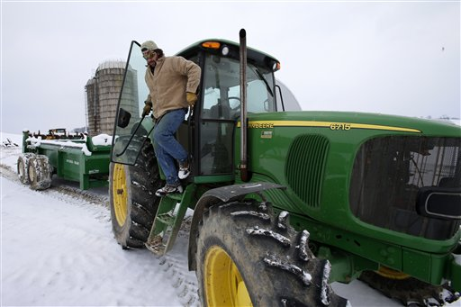 Shawn Georgetti climbs out of his John Deere tractor on his 167-acre family dairy farm in Avella, Pa., on Saturday. With royalties from a Range Resources gas well on his property, Georgetti has been able to buy newer farm equipment that's bigger, faster and more fuel-efficient.