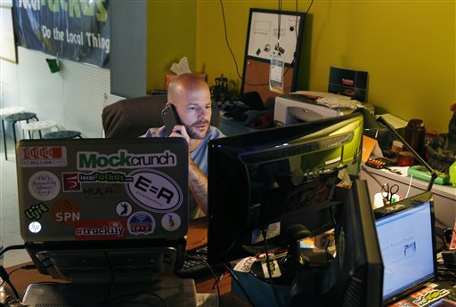 Matthew Marcus works at his desk in the basement of Kansas City Startup Village in Kansas City, Kan., on Friday. Marcus started the Village, which houses several startup companies and takes advantage of the high-speed Internet.
