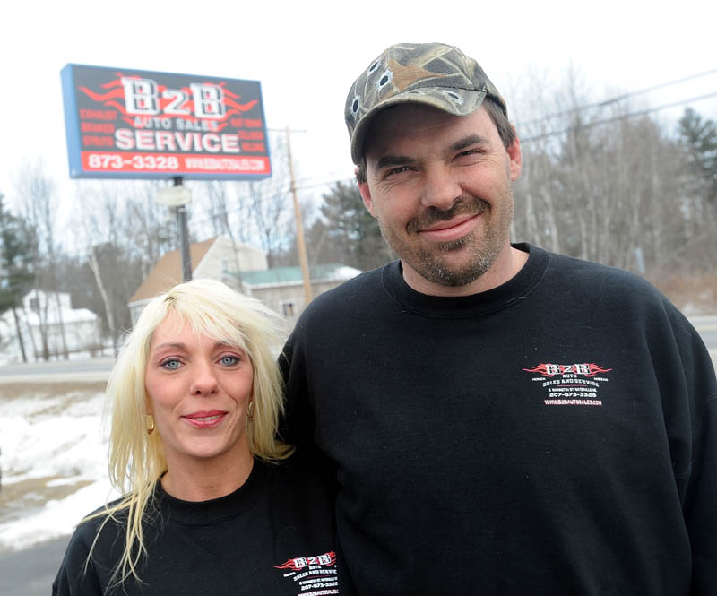 Shannon and Jason Hodgdon stand outsdie their B2B Car Service garage on Washington Street in Waterville on Thursday. The Hodgdons said they had to change the name of their business from Bumper to Bumper to B2B Auto Sales and Service, because of complaints of poor business practices by another garage in Bangor, named Bumper2Bumper.