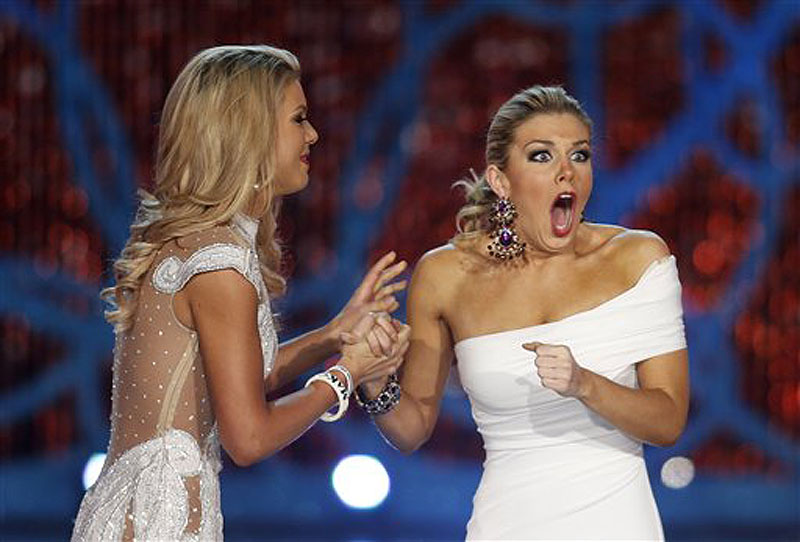 Miss New York Mallory Hagan, right, reacts with Miss South Carolina Ali Rogers as she is crowned Miss America 2013 on Saturday in Las Vegas.