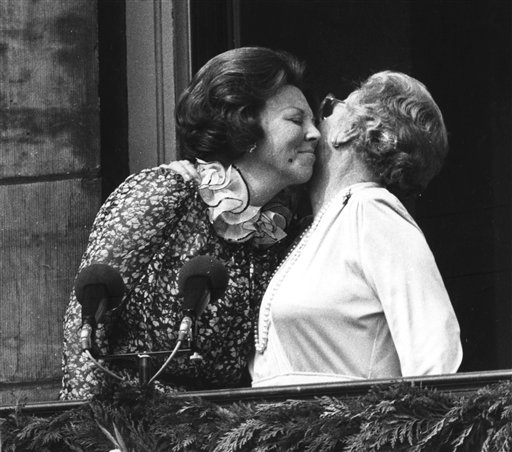 In this April 30, 1980, photo, Princess Juliana, right, just after her abdication, kisses her eldest daughter Queen Beatrix on the balcony of the Royal Palace in Amsterdam, Netherlands.