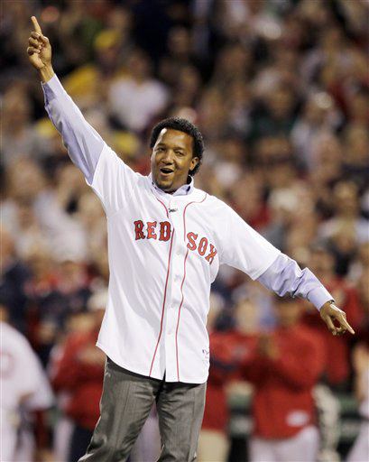 Former Boston Red Sox pitcher Pedro Martinez celebrates after throwing the ceremonial first pitch before the Red Sox' 2010 season opener against the New York Yankees.