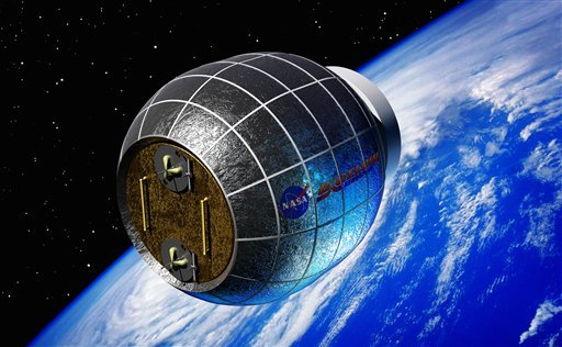 This artist's rendering provided by Bigelow Aerospace shows an inflatable space station. NASA is partnering with this commercial space company to test an inflatable room that can be compressed into a 7-foot tube for delivery to the International Space Station. NASA is expected to install the module by 2015.