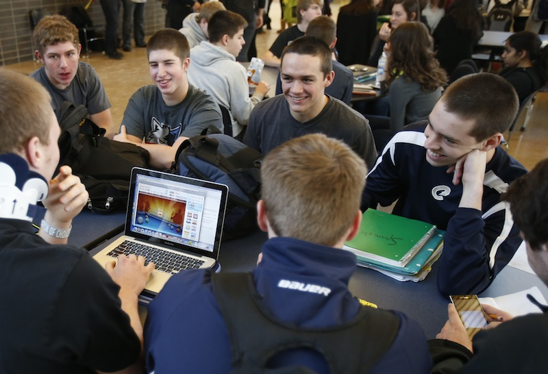 In this Jan. 18, 2013 photo, Chanhassen High School students relax while another plays a computer game during a 20-minute