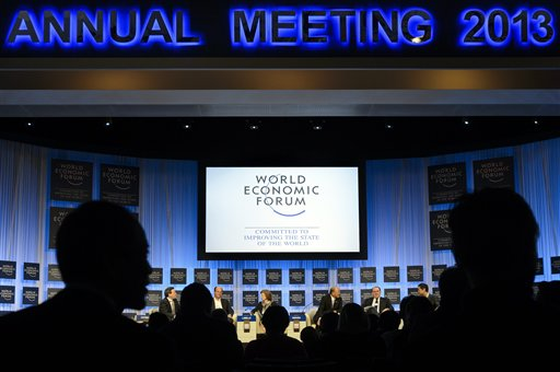 Participants listen to a panel session on the last day of the meeting of the World Economic Forum in Davos, Switzerland, on Saturday. The annual gathering of the global elite focused this year on how to promote economic growth and jobs, especially for the youth among the world's 220 million jobless.