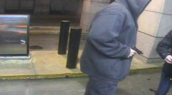 A surveillance image of the suspect, who is described as about 6 feet 2 inches tall, light-skinned and wearing jeans and a hooded sweatshirt.