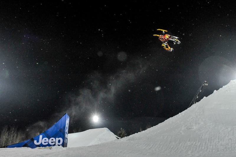 In this photo taken Jan. 24, 2013, Caleb Moore does a flip before he crashed during the ESPN Winter X Games snowmobile freestyle competition in Aspen, Colo. Moore died Thursday after suffering complications from injuries sustained during the snowmobile crash. He was 25.