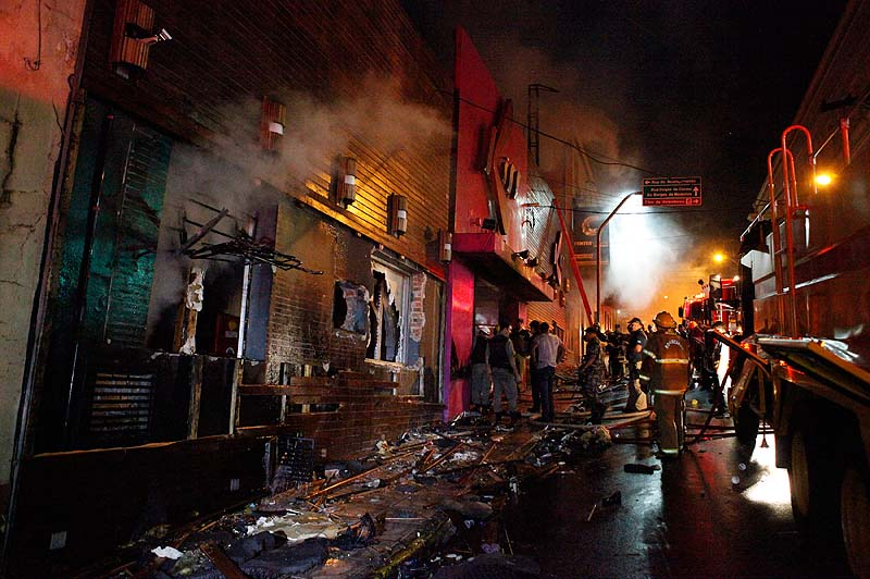 Firefighters work to douse a fire at the Kiss Club in Santa Maria city, Rio Grande do Sul state, Brazil, on Sunday. Firefighters say that the death toll from a fire that swept through a crowded nightclub in southern Brazil has risen to 231. Officials say the fire broke out at the club while a band was performing.