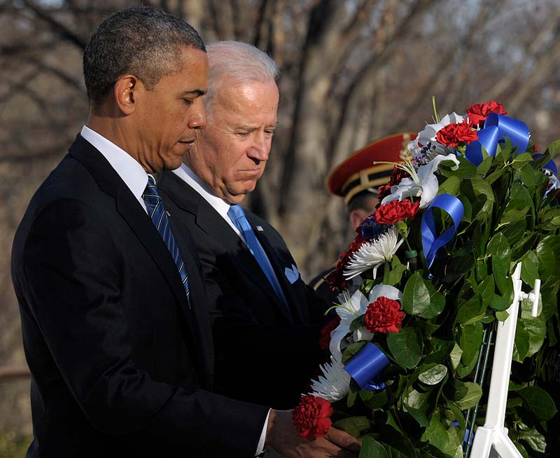 President Barack Obama and Vice President Joe Biden place a wreath at the Tomb of the Unknowns at Arlington National Cemetery in Arlington, Va., on Sunday.