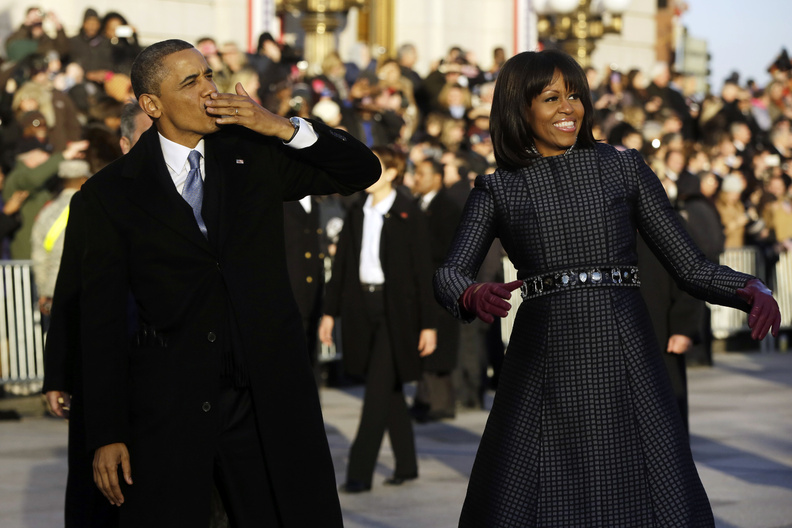 President Obama blows a kiss as he and first lady Michelle Obama walk on Pennsylvania Avenue near the White House during the Inauguration Parade. The ceremonies included appearances by pop-culture icons, including Beyonce, who sang the national anthem.