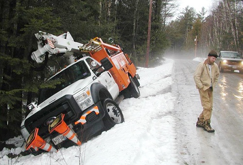A Central Maine Power truck slid off David Pond Road in Fayette Thursday morning, just off the East Road.