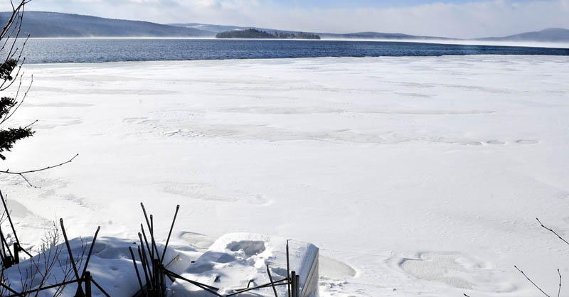OPEN WATER: A huge area of open water on Rangeley Lake can be seen several hundred yards from the shore where up to four snowmobilers may have died after breaking through the ice last Sunday. Strong winds have produced conditions that keep the ice from freezing.