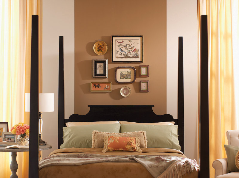 One designer suggests limiting the palette in a small room to two or three colors. In this bedroom, a wide stripe behind the bed makes the ceiling feel taller.
