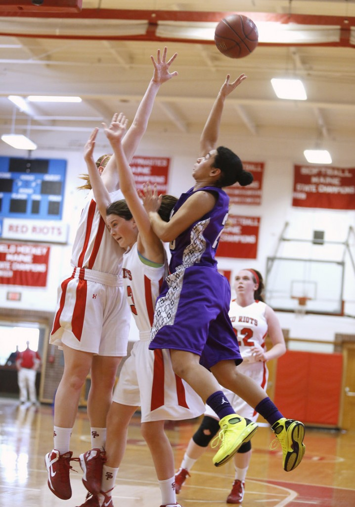 Keneisha DiRamio, who scored a game-high 14 points for Deering, shoots over Maddie Hasson, center, and Brianne Maloney of South Portland.
