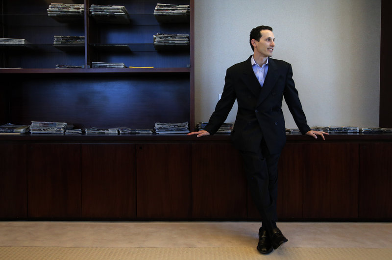 "Aaron Kushner, shown in his office at The Orange County Register in Santa Ana, Calif., says ""We're a little crazy in that we really do believe that we can grow this particular newspaper."""