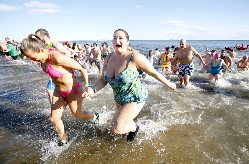 Hundreds take the plunge in the Atlantic Ocean during the 25th annual Lobster Dip to benefit Special Olympics Maine in Old Orchard Beach on Tuesday.