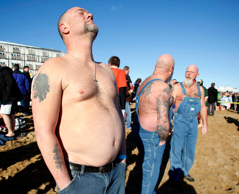 "Dean Devoe of Sanford, a member of the ""Hillbilly Rockers,"" gets mentally prepared to jump into the Atlantic Ocean during the 25th annual Lobster Dip to benefit Special Olympics Maine in front of The Brunswick in Old Orchard Beach on Tuesday."