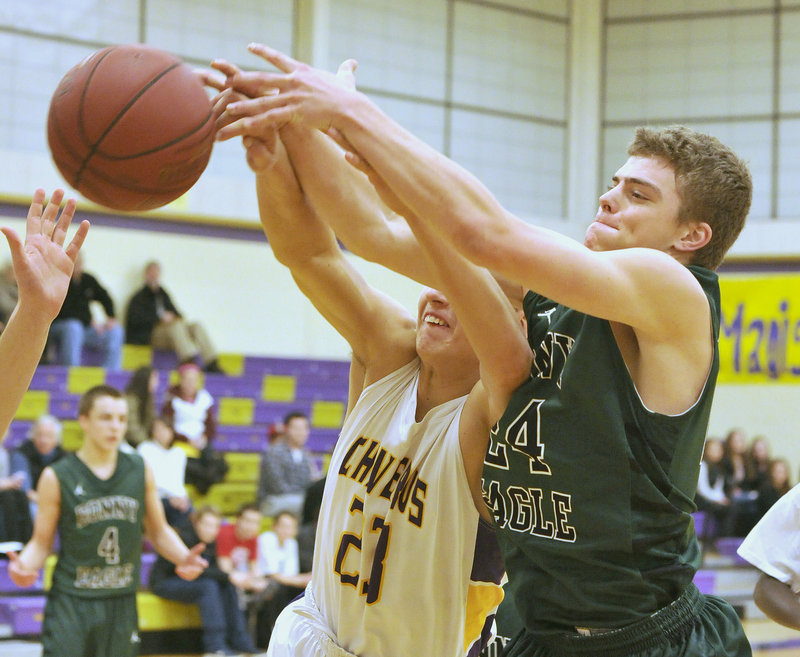 Zordan Holman of Cheverus, left, competes with Jon Thomas of Bonny Eagle for a rebound Wednesday night during Bonny Eagle's 69-48 victory in an SMAA game at Cheverus High.