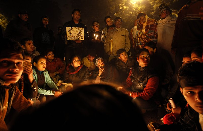 Indians gather for a candlelight vigil in memory of a gang-rape victim in New Delhi on Thursday. Five men face charges in the gang rape and death of a woman last month in India's capital.