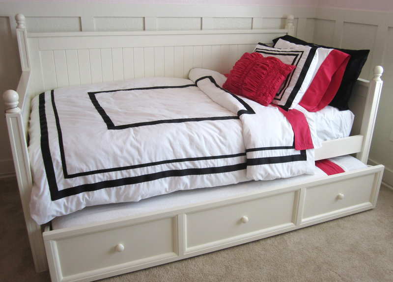 This is a knock-off version of a popular but pricier PB Teen bedding ensemble that uses inexpensive sheet sets and iron-on ribbons created by Allison Hepworth.