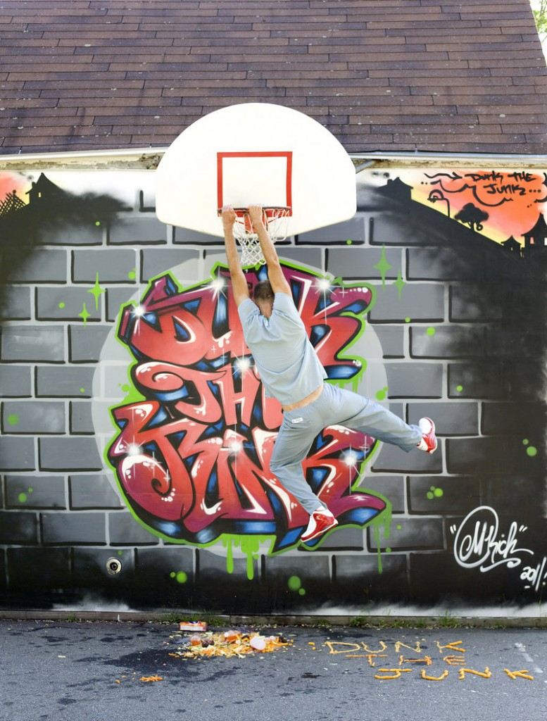 Dr. Kevin Strong slam-dunks junk food through a basketball hoop in front of a mural painted by Portland artist Mike Rich. More of Rich's work can be seen at mikerichdesign.com.