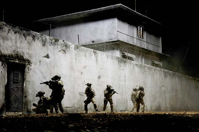 Navy SEALS outside the compound where they would find Osama bin Laden.