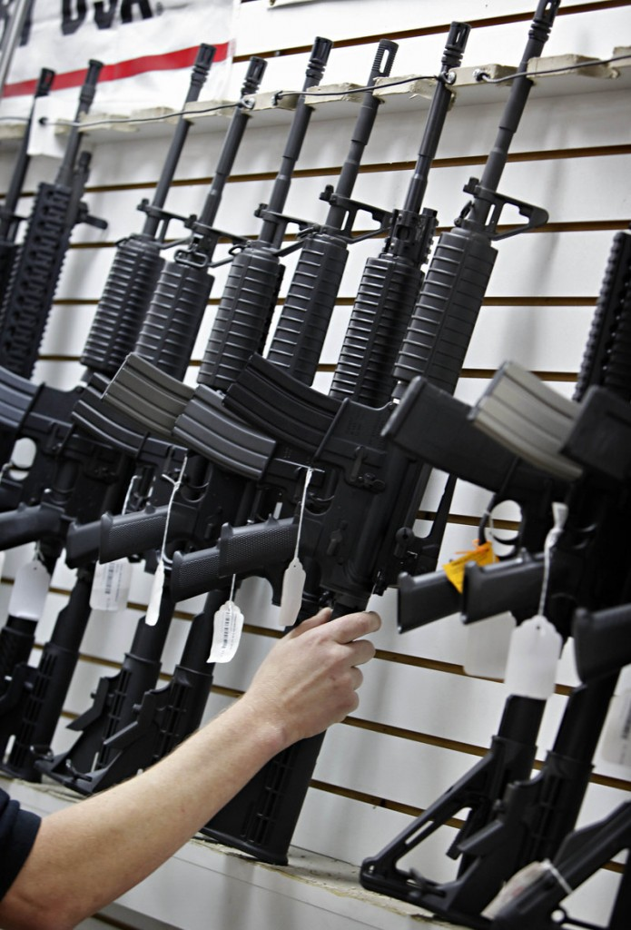 "An AR-15 is seen at a Mesa, Ariz., shooting range in 2010. The NRA's lobbying arm ""has spent millions of dollars"" to sway Congress to ""not only protect but actually extend the 'constitutional rights'"" of gun-rights activists, a reader says."