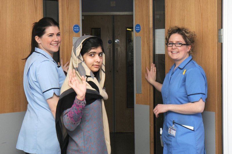 Malala Yousufzai waves goodbye as she leaves Queen Elizabeth Hospital in Birmingham, England, Friday. Experts are optimistic she has a good chance of recovery.