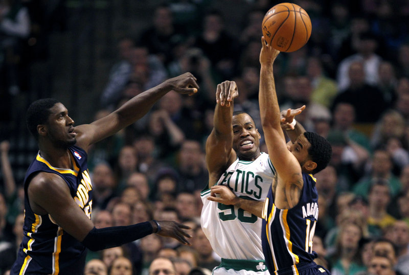 Celtics center Jason Collins and Indiana guard D.J. Augustin vie for a loose ball during first-quarter action of Friday's game in Boston. Roy Hibbert is at left.