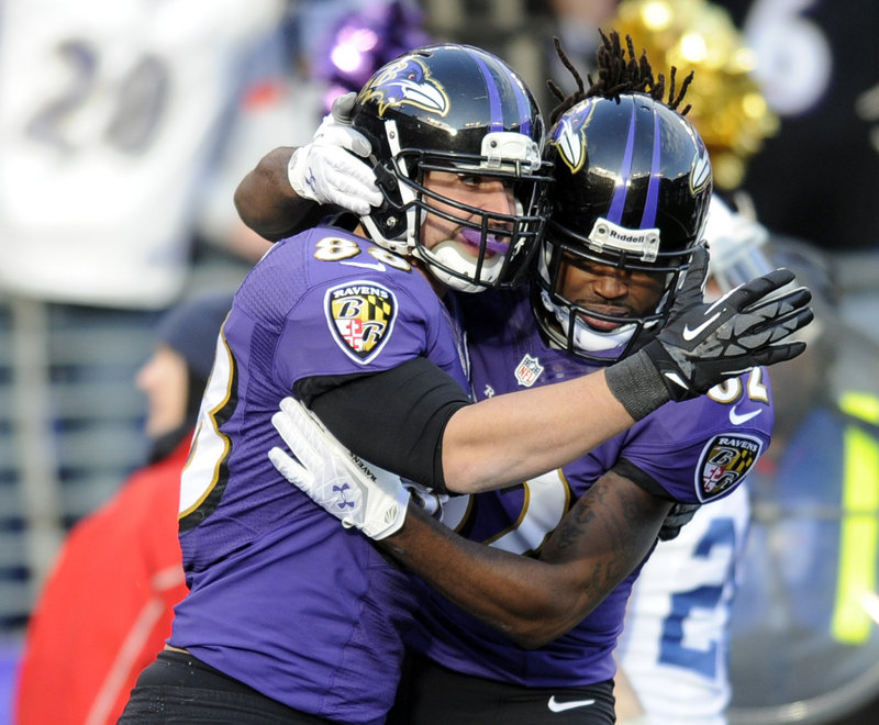 Dennis Pitta, left, celebrates with Torrey Smith after catching a touchdown pass that helped Baltimore earn a 24-9 victory over the Colts.