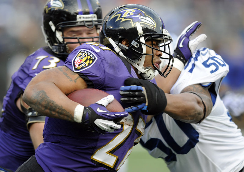 Ravens running back Ray Rice (27) is a hit by Colts linebacker Jerrell Freeman (50). Rice had 70 yards on 15 carries and a 47-yard reception.