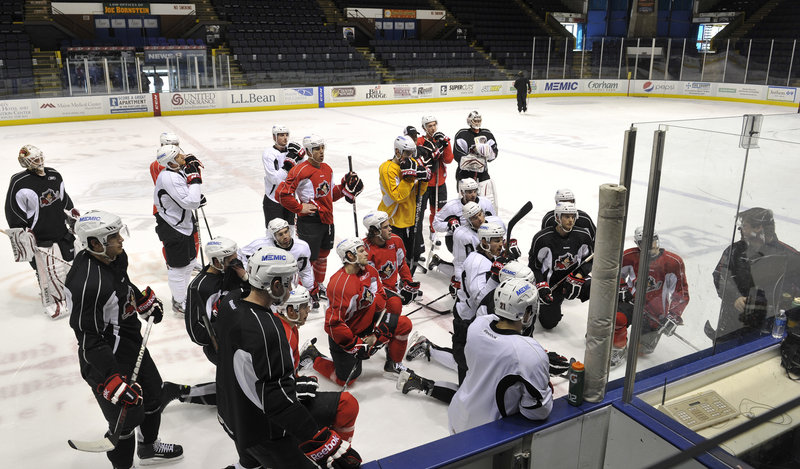 The Portland Pirates gather around Coach Ray Edwards during Monday's practice at the Cumberland County Civic Center. The Pirates could be losing as many as four players to the parent Phoenix Coyotes with the NHL labor dispute settled.