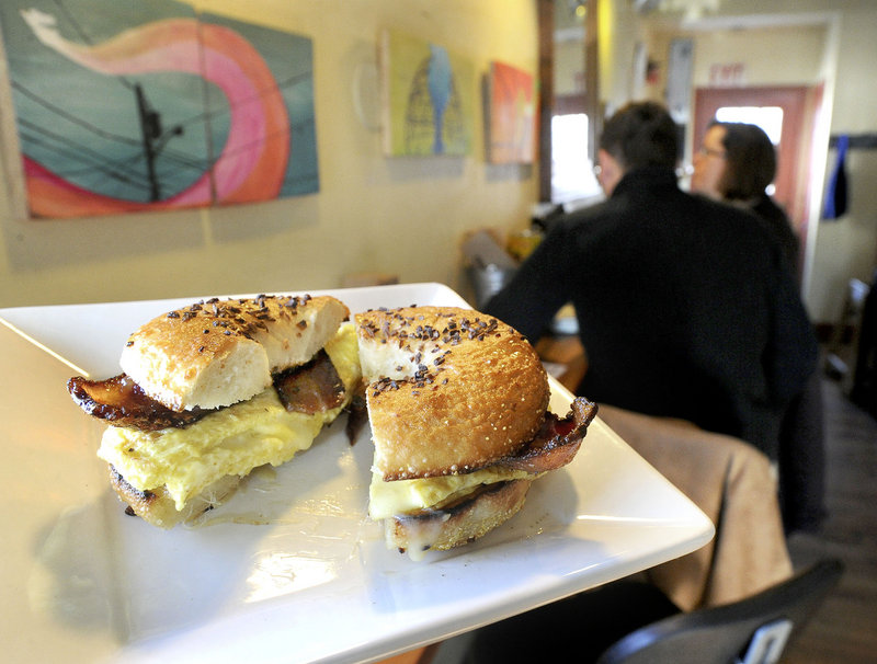 A bacon, egg and cheese bagel sandwich makes its way to a customer at 158 Picket Street Cafe.