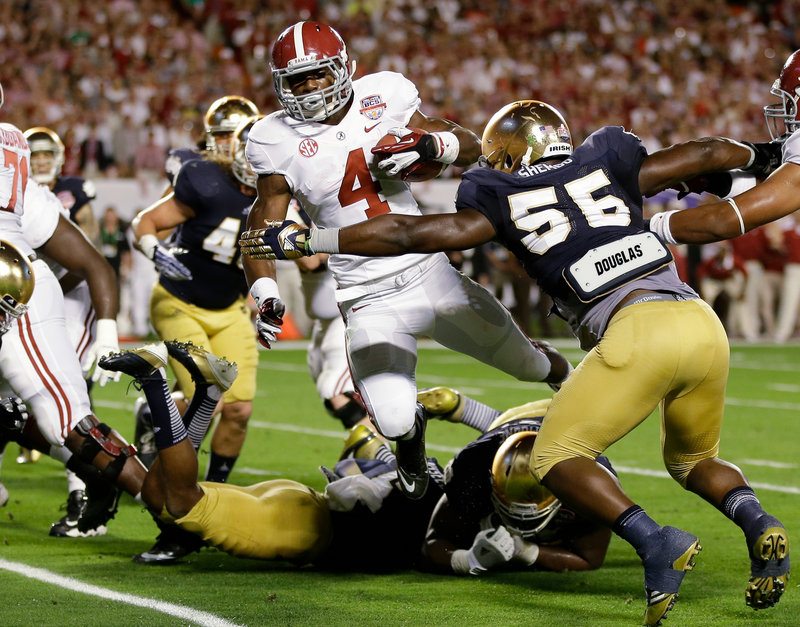 T.J. Yeldon of Alabama runs through the Notre Dame defense. Yeldon ran 21 times for 108 yards and one touchdown in the 42-14 win.