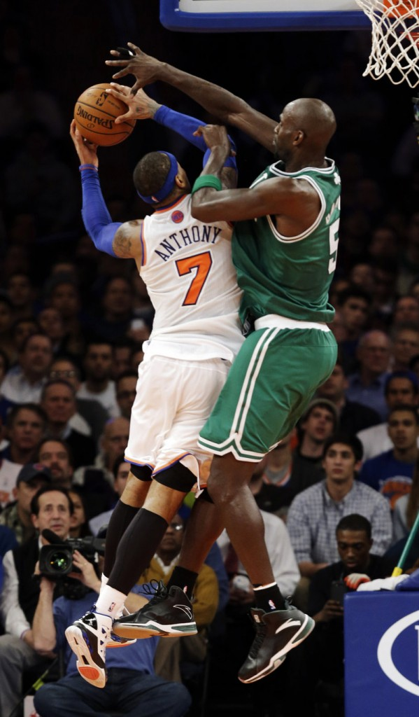 Boston's Kevin Garnett, right, goes up strong against New York's Carmelo Anthony as the Celtics held the Knicks to 40 second-half points in a 102-96 win on Monday.