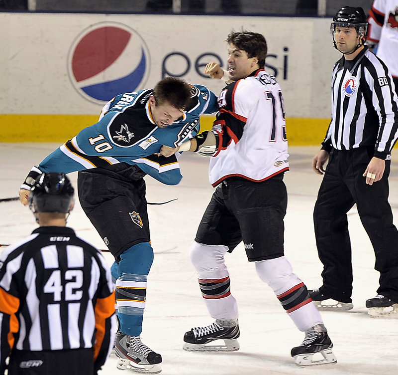 Joel Rechlicz gets ready to land a right to Worcester's Frazer McLaren in a first-period fight in Portland's 7-3 win.
