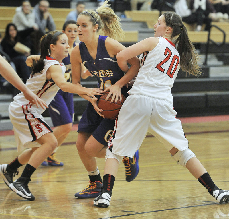 Brooke Flaherty, who scored 23 points for Cheverus, is fouled while driving between Taylor LeBorgne, left, and Ashley Briggs of Scarborough.