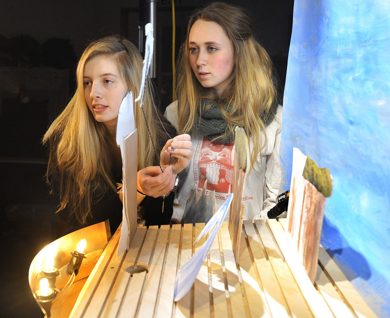 "Students Sarah Grace, left, and Charlotte Spritz work on producing a film version of ""Frankenstein"" using small paper puppets at Figures of Speech Theatre in Freeport."