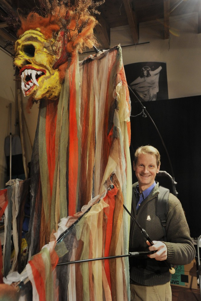"John Farrell of Figures of Speech Theatre in Freeport with a giant puppet he created to portray the witch Sycorax in ""The Tempest."" Farrell and his wife, Carol, were among the first puppet theater artists based in Maine and have taken their performances around the world."