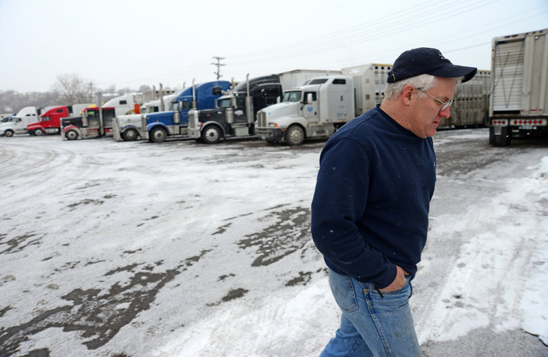Trucker Roy Olds of Dubuque, Iowa, shown at a truck stop in Minneapolis, Minn., in December, believes big companies can't retain drivers because they don't pay enough.