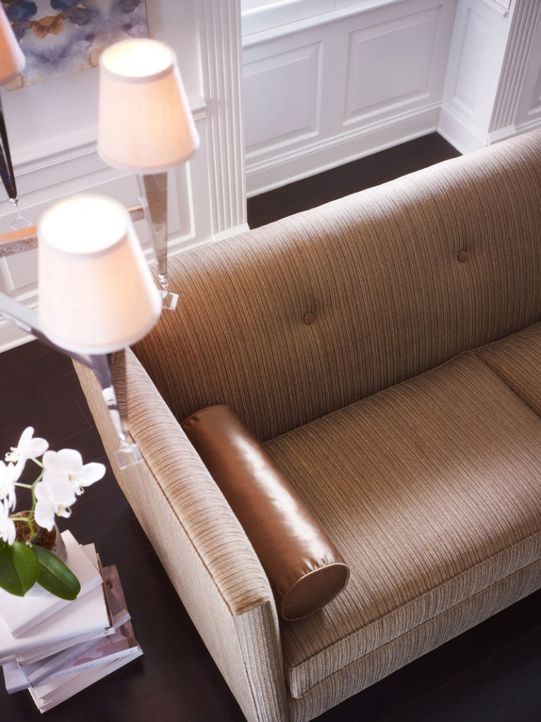 A Muse sofa from the Candice Olson collection boasts an elegant sheen, which is further enhanced by a silk accent pillow. The luminous look sashayed off the fashion runway and into the home.