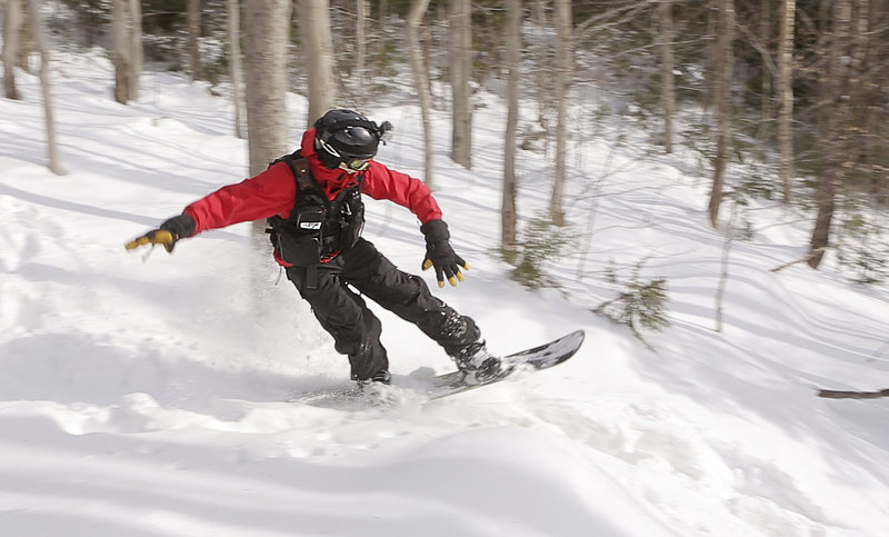 John McElrath finds the deep snow on the new Moxie trail to his liking during a test run at the Rumford resort.
