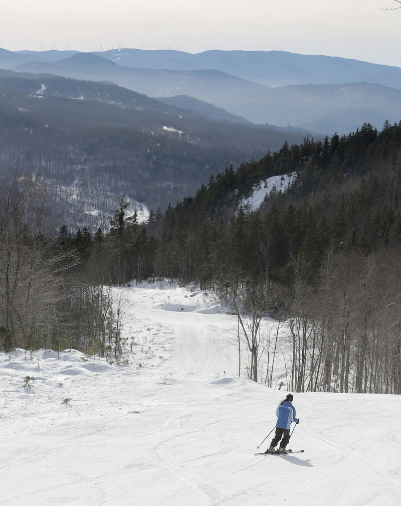 Paige Carter, marketing director of Black Mountain, skis the Allagash Trail, which offers a panoramic view of neighboring mountain ranges.