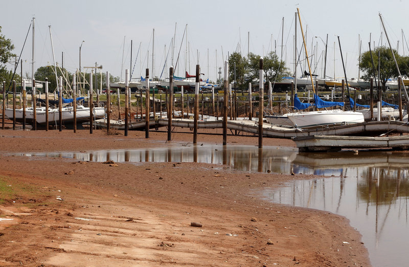 This harbor on Lake Hefner in Oklahoma City is nearly dry in September. The latest climate assessment, issued every four years, gives a bracing picture of environmental changes and natural disasters that mounting scientific evidence indicates is fostered by climate change.