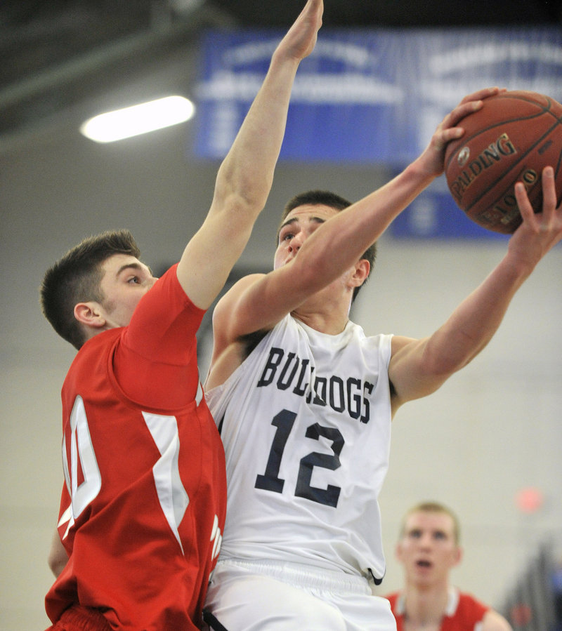Justin Zukowski drives to the basket Friday during Portland's 63-47 win over South Portland. The Bulldogs are 10-0 and ranked first in Western Class A.