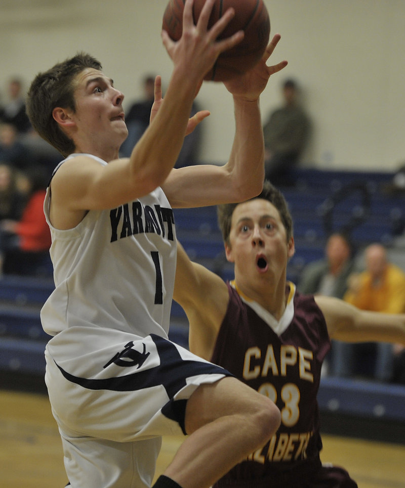 David Murphy, who led Yarmouth with 16 points, drives to the basket against Xander Schonewolf of Cape Elizabeth.