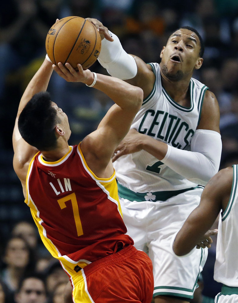 Celtics center Jared Sullinger blocks a shot by Houston's Jeremy Lin during third-quarter action of Friday's game in Boston, won by the Celtics.