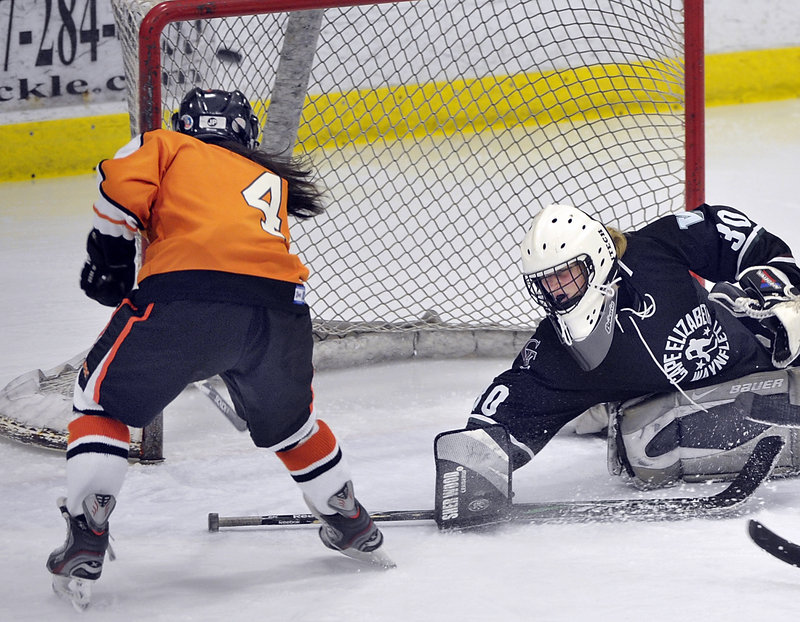 Katherine Dumoulin of Biddeford fires the puck into the net Saturday as Cape Elizabeth/Waynflete goalie Lily Jordan attempts to make the save. Biddeford improved to 6-6 with a 6-0 victory.