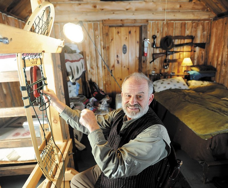 Dave Giampetruzzi, 63, of China, a 43-year Army veteran, fabricates a snowshoe in his cabin at Pine Grove Lodge, a 50-room hunting and fishing lodge in Pleasant Ridge Plantation. Giampetruzzi teaches snowshoe making for the Pine Grove Program, which hosts veterans and service members on select weekends for therapeutic wilderness adventures.