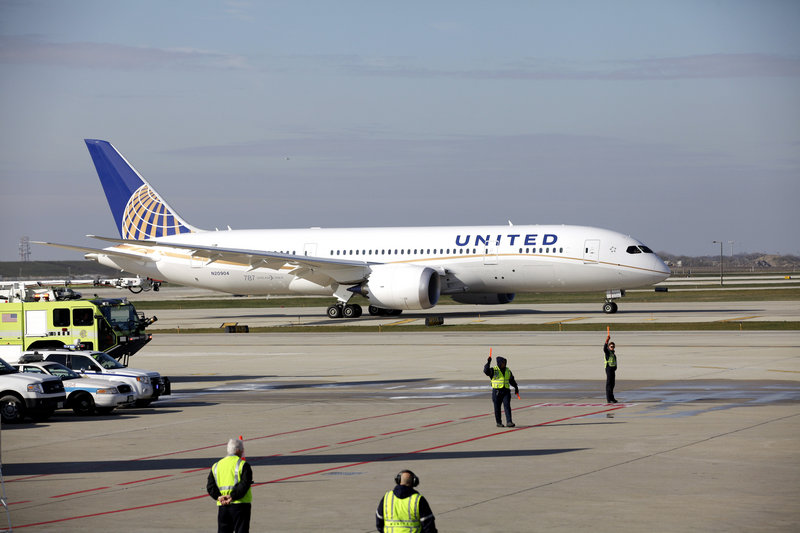A United Airlines 787 Dreamliner arrives at O'Hare International Airport in Chicago. The Regional Transportation Authority says it will sue the airline for falsely claiming to buy jet fuel out of a small office in Sycamore, 70 miles away.
